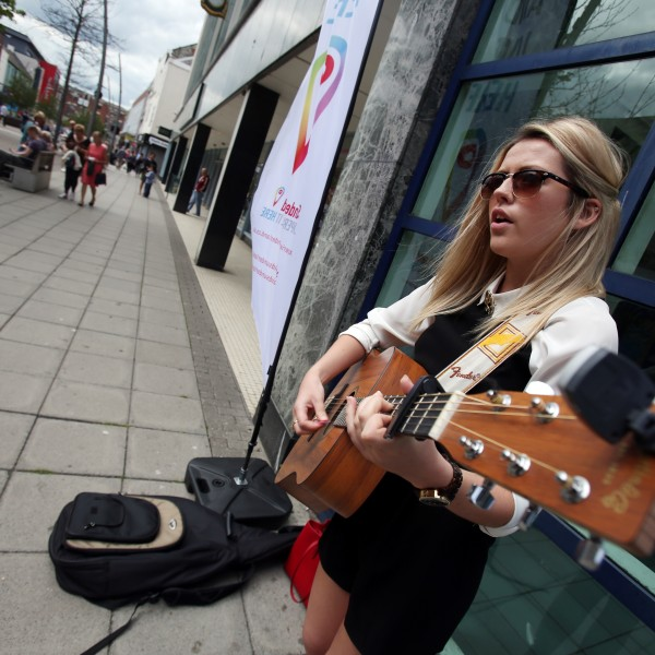 Busker Annabel Pattinson outside the Bridges